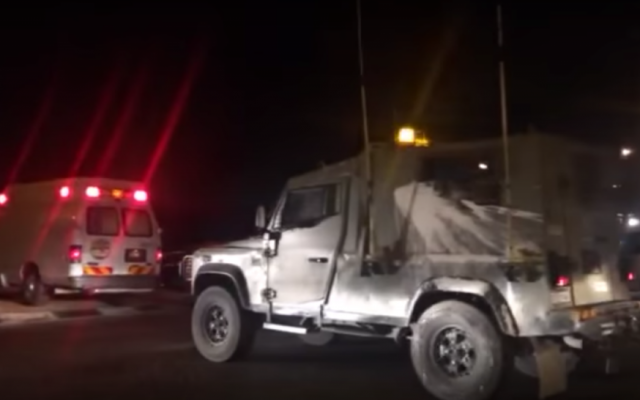 Emergency services at the scene of an explosion next to a West Bank checkpoint outside of the Palestinian village of Hizme, May 10, 2016. (Screencapture)