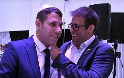 Moshe Ben-Zaken, left, celebrates his son's circumcision with MK Oren Hazan, right. (Screen capture: YouTube)