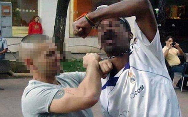 Donato di Mauro mock-strangling a black homeless man in the city of Belo Horizonte in a Facebook photo. (JTA/Screenshot from Facebook)