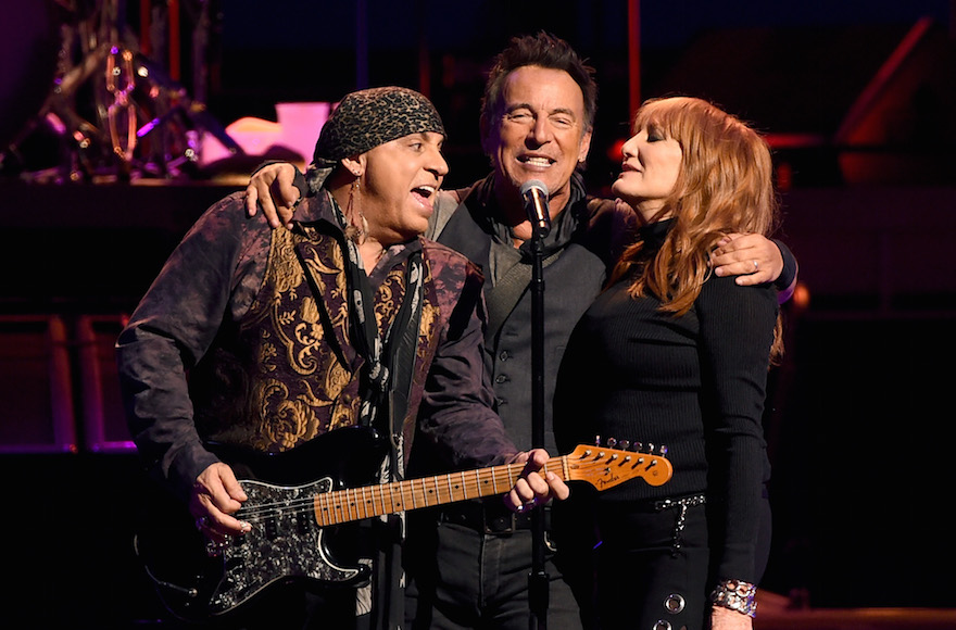 Steven Van Zandt, Bruce Springsteen and Patti Scialfa of Bruce Springsteen and the E Street Band perform at the Los Angeles Sports Arena on March 15, 2016 in Los Angeles, California. (Photo by Kevin Winter/Getty Images via JTA)