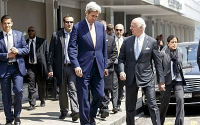 U.S. Secretary of State John Kerry, left, and the UN Special Envoy for Syria Staffan de Mistura, right, leave after a press briefing after their meeting on Syria in Geneva, Switzerland, Monday, May 2, 2016. (Salvatore Di Nolfi/Keystone via AP)