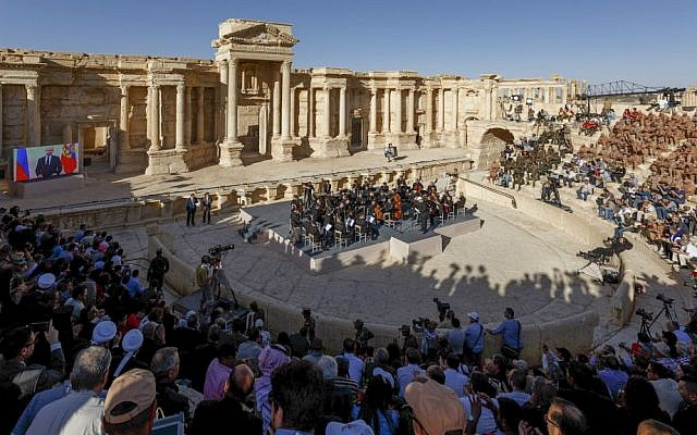 This Thursday, May 5, 2016 photo provided by the Russian Defense Ministry Press Service, shows the concert at the UNESCO world heritage site of Palmyra, the central city of Homs, where renowned conductor Valery Gergiev leads a performance by the Mariinsky Symphony Orchestra from St. Petersburg, Russia. (Olga Balashova/Russian Defense Ministry Press Service via AP)