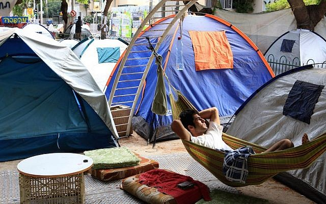 Illustrative: Young Israelis sleeping in tents on Rothschild Boulevard in Tel Aviv in protest of high housing prices, August 10, 2011. (Liron Almog/Flash90)
