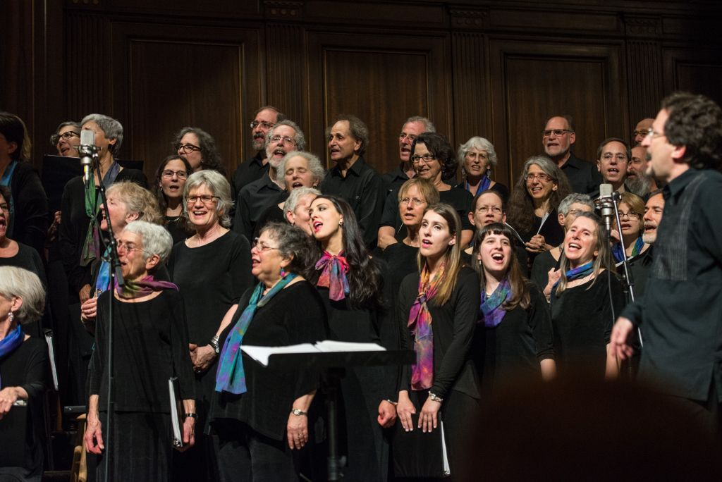 Conductor Steven Lipsitt (far right) led A Besere Velt, Boston Workmen's Circle's Yiddish chorus in a May 16, 2016 tribute to Sholem Aleichem on the centennial of his death, with The Klezmatics at Boston's Temple Ohabei Shalom (Derek Kouyoumjian/ courtesy Boston Workmen's Circle)