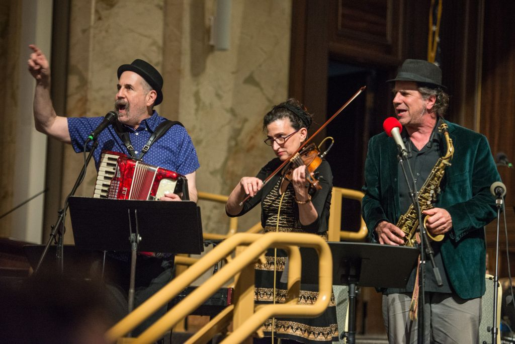 Lorin Sklamberg (left), Deborah Strauss and Matt Darriau of the Klezmatics playing at the centennial yahrzeit celebration at Boston's Temple Ohabei Shalom (Derek Kouyoumjian/ courtesy Boston Workmen's Circle)