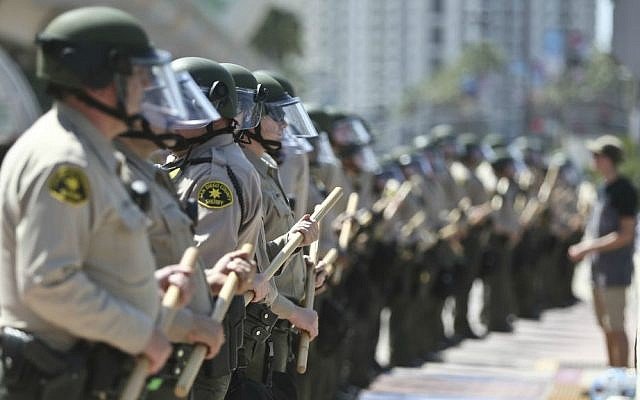 The San Diego County Sheriff Department stands in front of the San Diego Convention Center where Donald Trump spoke Friday, May 27, 2016, in San Diego. (AP Photo/Lenny Ignelzi)