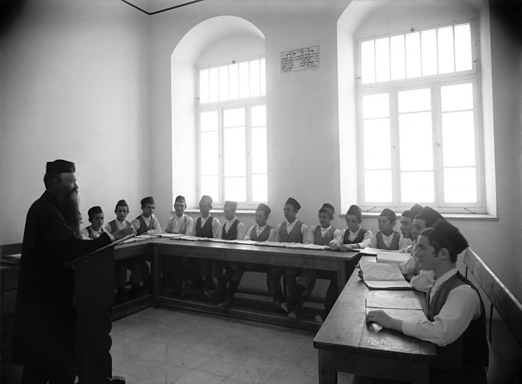 A Torah lesson at the Diskin Great Orphanage in Givat Shaul in the 1920s, a digital print from glass plate negative (Courtesy Tsadok Bassan/Central Zionist Archives)