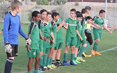 Members of the Tzav Pius 13-year-olds' soccer team in the city of Pardes Hanna during practice in an educational exercise meant to teach teamwork. (Ben Sales)