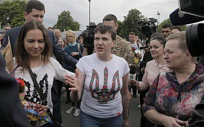 Ukrainian jailed pilot Nadezhda Savchenko upon her arrival at Boryspil airport outside Kiev, Ukraine, May 25, 2016. (AP Photo/Efrem Lukatsky)