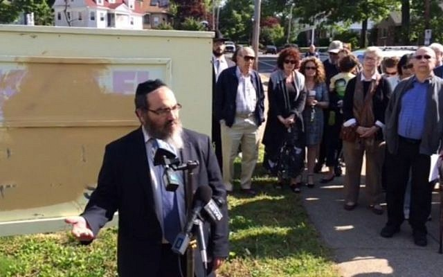 Rabbi Raphie Schochet speaks to the press outside Congregation Ohawe Shalom in Pawtucket, Rhode Island on May 23, 2016. (screen capture: Providence Journal)