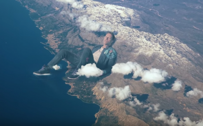 Chris Martin as a giant in the video of his new single 'Up&Up,' created by Jerusalemite Vania Heymann and released on May 16, 2016. (YouTube: screenshot)