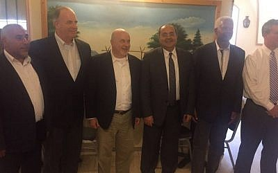 Joint (Arab) List MKs Ahmad Tibi (C) and Taleb Abu Arar (L) seen with members of a visiting delegation of US congressmen in Jerusalem on May 28, 2016. (Courtesy Joint List)