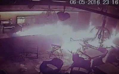 Flames spread through the Ta'am Deli and Grill kosher restaurant after an arson attack in Manchester, England, May 6, 2016. (YouTube/New World)