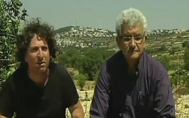 Jewish settler Eliaz Cohen, left, and PLO member Muhammad Beiruti sit together near Efrat, in the West Bank. The two are members of the new movement Two States, One Homeland. (Screen capture Channel 2)