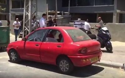 The vehicle in Ashdod where a baby died of heat stroke after being left for hours in the sun. (screen capture: YouTube/MDA)