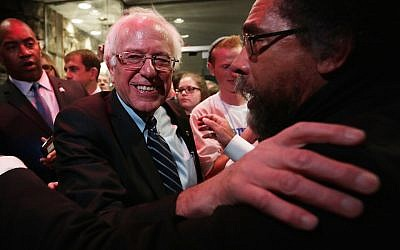 Democratic presidential candidate Sen. Bernie Sanders (left) and philosopher Cornel West (right) at the second Democratic presidential debate in Des Moines, Iowa, on November 14, 2015. (Alex Wong/Getty Images via JTA)
