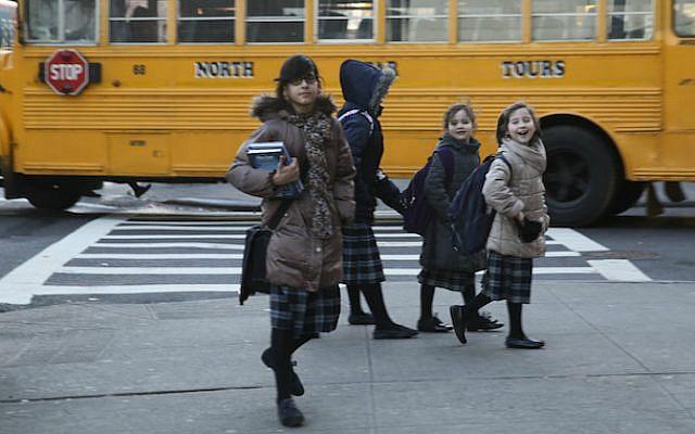 Haredi Orthodox Jewish girls in the Borough Park neighborhood of Brooklyn, Jan. 1, 2014. (Nati Shohat/Flash90)