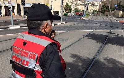 Emergency crews work to clear Jerusalem's Moshe Dayan Boulevard after an unknown chemical leaked from a truck on May 17, 2016. (Jerusalem Fire and Rescue Services)