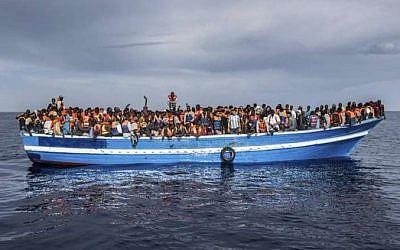 Italian coast guard rescues migrants off the coast of Sicily, May 12, 2016. (Italian Navy/Massimo Sestini via UNHCR Italia)