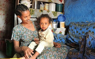 Alementu Lake, 25, a drink seller who lives near the center of Gondar, with her two-year-old daughter, Habtam, on April 15, 2016. (Melanie Lidman/Times of Israel)