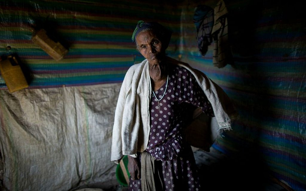 Mulu Lagese, 74, in her rental home in Gondar, Ethiopia, on April 24, 2016. Lagese is likely suffering from a goiter, which is linked to a lack of iodine. (Miriam Alster/Flash 90)