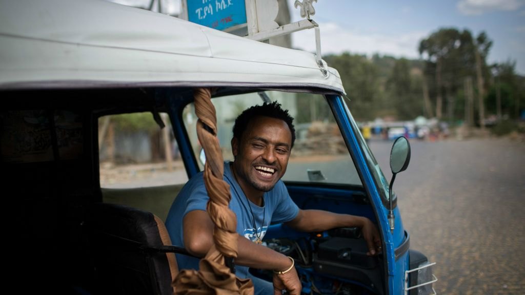 Samuel Araya, 32, with his motorcycle taxi in Gondar. Having only recently discovered his Judaism, he is worried people think he is trying to take advantage of aliyah to Israel, and he is struggling to find proof of his mother's Judaism. (Miriam Alster/Flash 90)