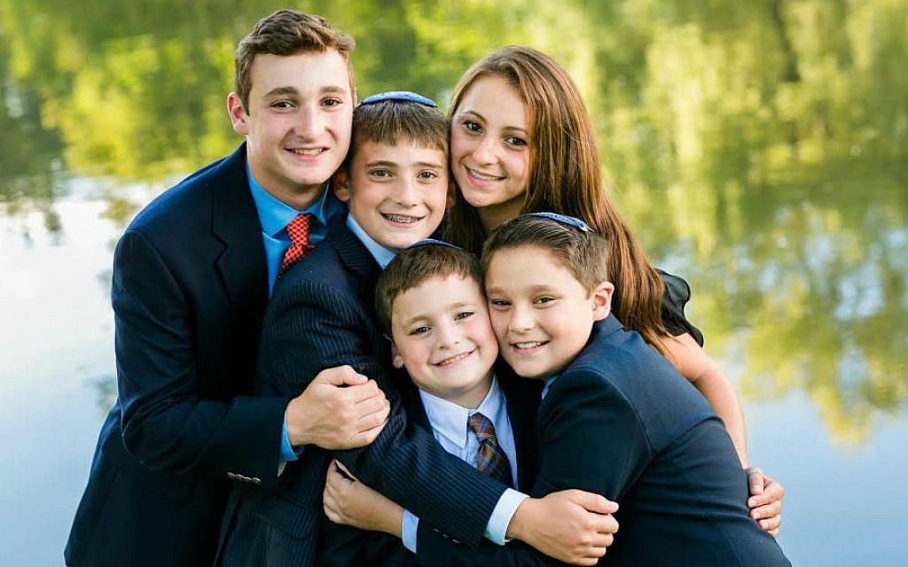 Ezra Schwartz, far left, was murdered by a Palestinian terrorist south of Jerusalem on November 19, 2015. At the time, Schwartz was spending a gap year at a Beit Shemesh yeshiva. Here he poses with his four younger siblings in Sharon, Massachusetts. (Facebook)