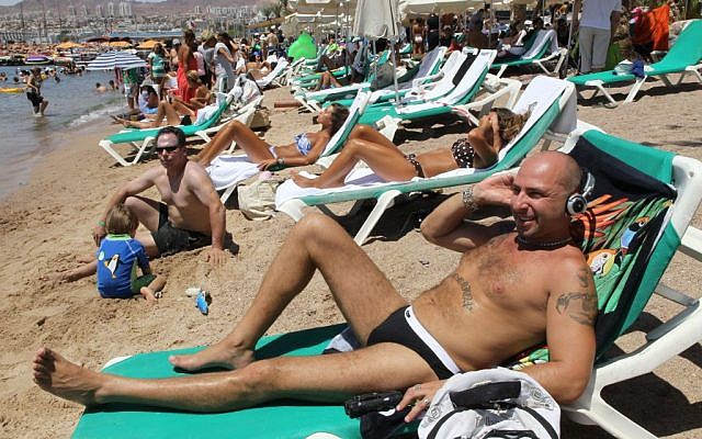 Illustrative photo of Israelis relaxing on the beach in the southern city of Eilat. (Nati Shohat/Flash90)