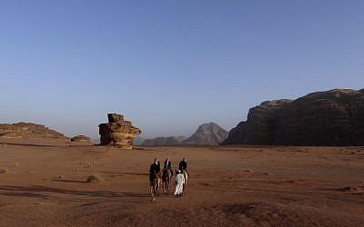Bedoins seen riding camels in tdesert in Jordan, February 8, 2013. (Lucie March/Flash90)