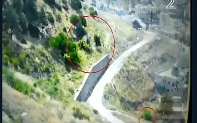 Security footage shows arson suspect fleeing area near Ofrit military base outside Jerusalem after bushes catch fire, May 14, 2016. (Channel 2 screenshot)