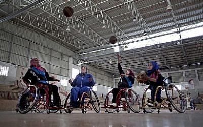 Disabled Palestinian women take part in a basketball training session with top US coach Jess Markt in the Khan Younis refugee camp, southern Gaza Strip, May 28, 2016. (AP/Khalil Hamra)