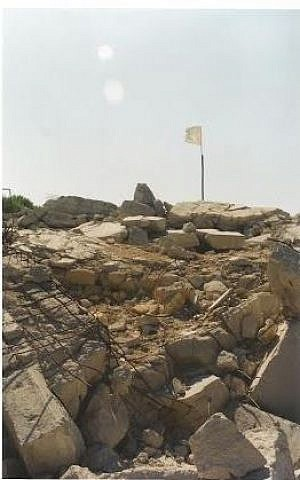 A Hezbollah flag flies over the remains of the Pumpkin fort in southern Lebanon, after the IDF's withdrawal in 2000 (Courtesy Matti Friedman)