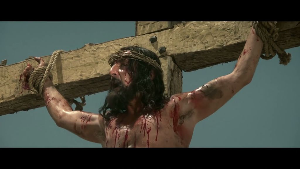 Actor Gilles Lellouche as Jesus, in 'They are Everywhere' (YouTube screenshot)