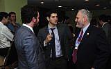 Chanan Weissman, center, speaking with Jewish Federations Washington director William Daroff, right, and Jordan Hirsch. (Ron Sachs from CNP/Courtesy of Jewish Insider)