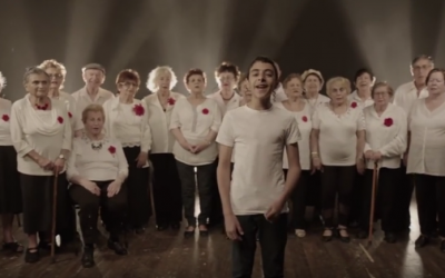 Uziya Zadok and the Amcha Choir, singing Yehuda Poliker and Ya'akov Gilad's song, 'When You Grow Up,' as part of a fundraising campaign created by the International Fellowship of Christians and Jews for Holocaust Remembrance Day 2016 (Courtesy YouTube screengrab)
