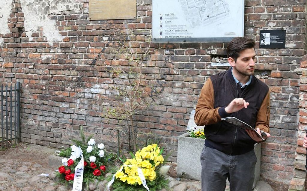 Polish tour guide Kuba Wesolowski at a surviving wall of the Warsaw ghetto. (Shmuel Bar-Am)
