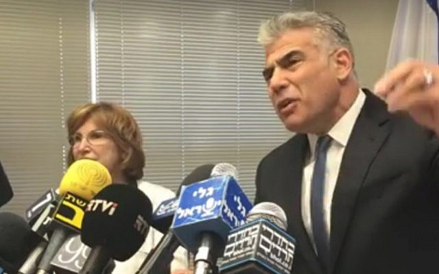 Yesh Atid leader Yair Lapid, right, is accompanied by MK Yael German as he speaks at a press conference from the Knesset in Jerusalem on May 23, 2016 (screen capture: Facebook)