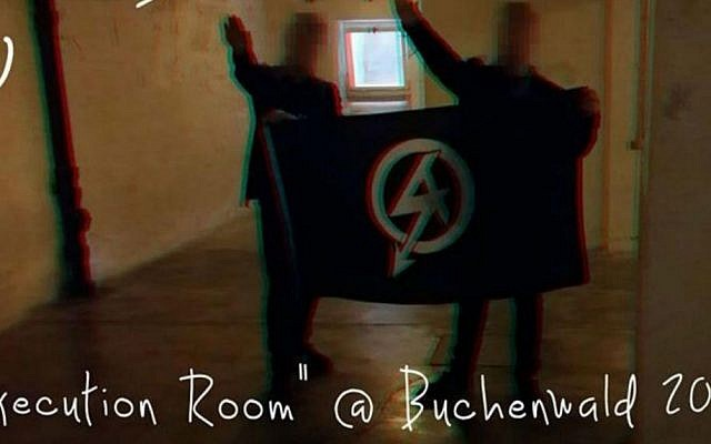 The neo-Nazi British group National Action posted this photo on Twitter showing two men performing the Nazi salute in a cellar at the Buchenwald concentration camp where thousands of corpses were stored before cremation. (Twitter)