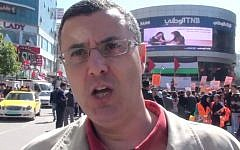 BDS activist Omar Barghouti at a pro-boycott rally in Ramallah, February 2016. (YouTube screen capture)