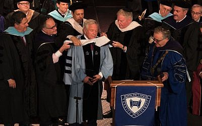 Robert Kraft being 'hooded' at the Yeshiva University commencement in New York City, May 26, 2016. (Adena Stevens/Yeshiva University via JTA)