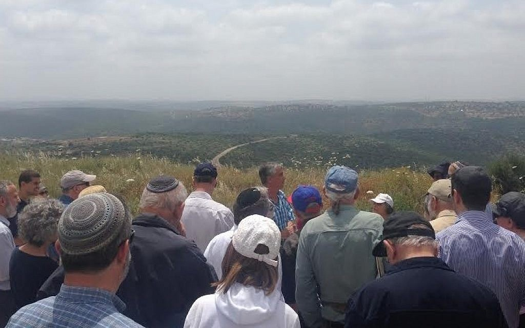 A One Israel Fund tour group visits the hills near Karnei Shomron in the West Bank (Eliyahu Kamisher)