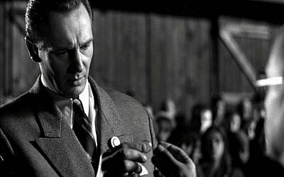 Liam Neeson, as Oskar Schindler, holds the ring in Schindler's List (Courtesy)