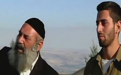 Rabbi Avraham Sinai (L) and son Amos look out at the Lebanese border (Channel 2 news)