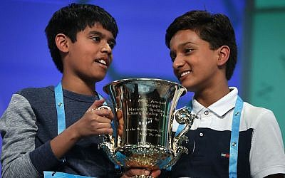 Spellers Nihar Saireddy Janga, left, of Texas and Jairam Jagadeesh Hathwar of New York hold a trophy after the finals of the 2016 Scripps National Spelling Bee, on May 26, 2016 in National Harbor, Maryland. (Photo by Alex Wong/Getty Images via JTA)