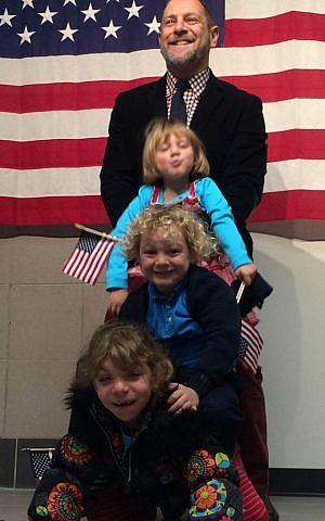 Rabbi Amichai Lau-Lavie with his three children at his American citizenship ceremony, 2014. (Courtesy)
