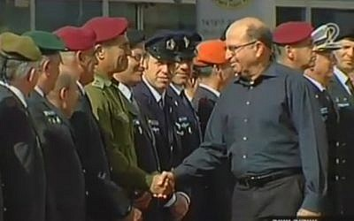 Outgoing Defense Minister Moshe Ya'alon shakes hands with IDF top brass during a departure ceremony at the Kiyra military compound in Tel Aviv on May 22, 2016 (screen capture: Channel 2)