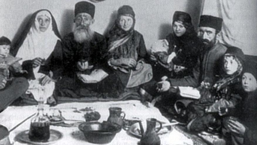 Late-19th century photograph of a family from Quba, near Krasnaya Sloboda celebrating the Passover holiday. (Krasnaya Sloboda archives)