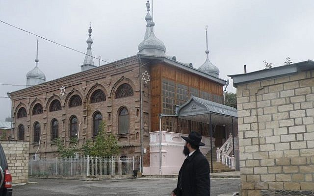 Rabbi Yona Yaakobi stands in front of the larger synagogue currently active in the Jewish Azerbaijani town of Krasnaya Sloboda. (Courtesy)
