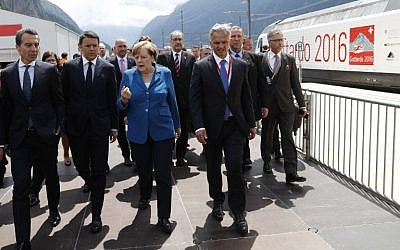 German Chancellor Angela Merkel, center, speaks with Austrian Chancellor Christian Kern, left, Italian Prime Minister Matteo Renzi, second left, and Swiss Federal Councillor Didier Burkhalter, second right, on the opening day of the Gotthard Rail Tunnel in Erstfeld on June 1, 2016. (AFP/Peter Klaunzer/Pool)