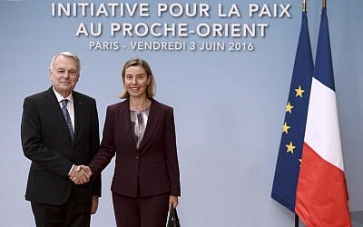 European Union High Representative for Foreign Affairs, Federica Mogherini, right, is welcomed by French Foreign minister Jean-Marc Ayrault prior to an international and interministerial meeting in a bid to revive the Israeli-Palestinian peace process, in Paris, on June 3, 2016. (AFP/Pool/Stephane de Sakutin)